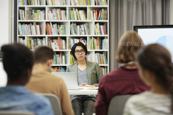 Young writer presenting his book - Stock Photo - Images
