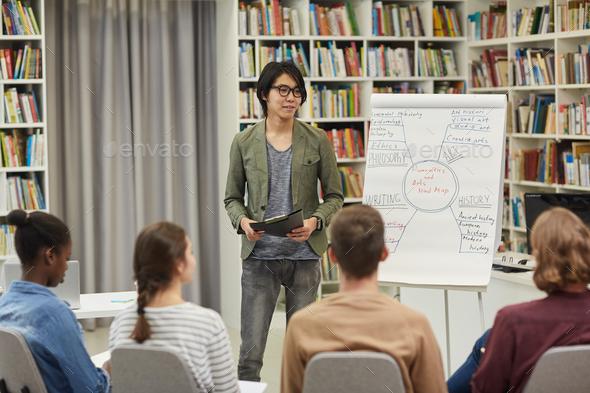 Businessman presenting his presentation - Stock Photo - Images