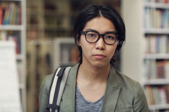 Asian student in the library - Stock Photo - Images