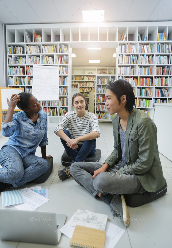 People preparing the project in the library - Stock Photo - Images