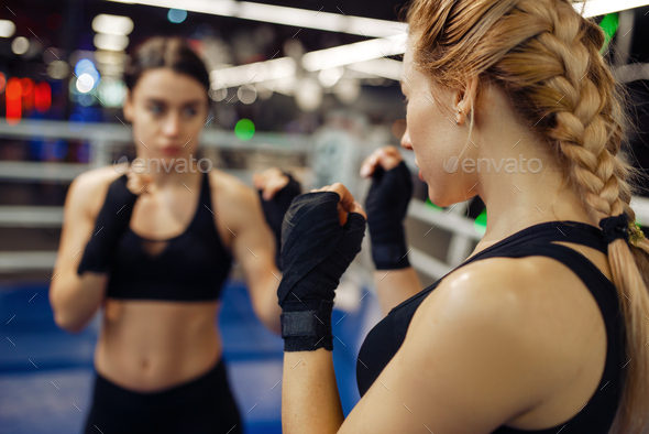 Women in boxing bandages on the ring, box training - Stock Photo - Images
