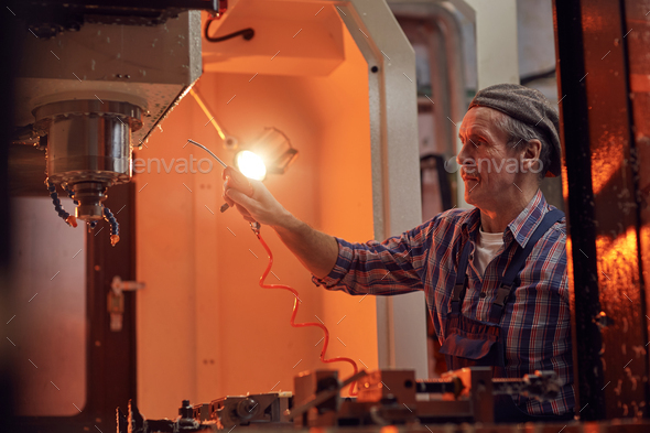 Man in the factory - Stock Photo - Images