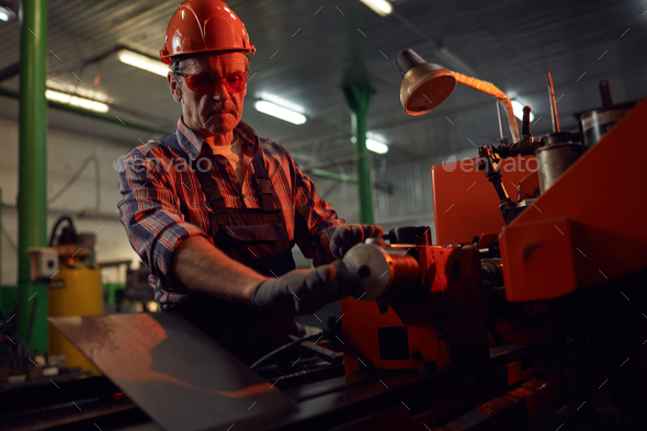 Man making the metal on lathe - Stock Photo - Images