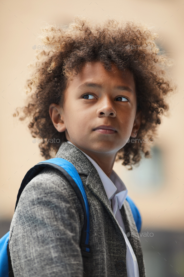African schoolboy with backpack - Stock Photo - Images