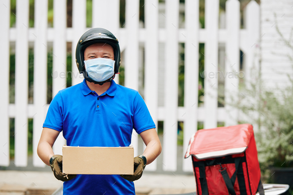 Courier delivering packages - Stock Photo - Images
