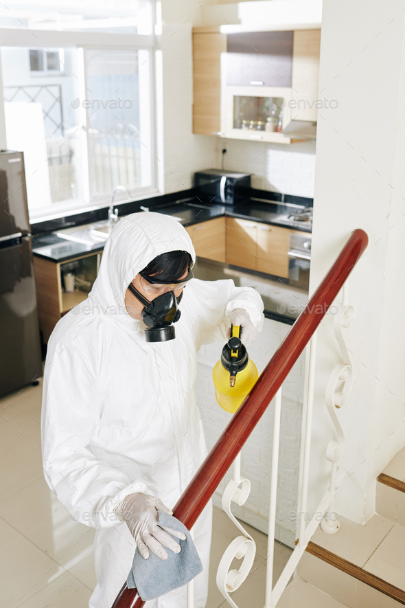 Service worker wiping surfaces in hous - Stock Photo - Images