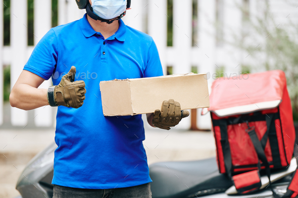 Delivery man with cardboard box - Stock Photo - Images
