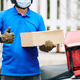 Delivery man with cardboard box - PhotoDune Item for Sale