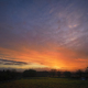 Orange fiery Cloudscape at Sunrise over Pasture land - PhotoDune Item for Sale
