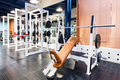 Empty bench press exercise machine in modern gym - PhotoDune Item for Sale