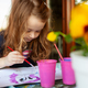 Three year old girl paints with watercolors on the terrace. - PhotoDune Item for Sale