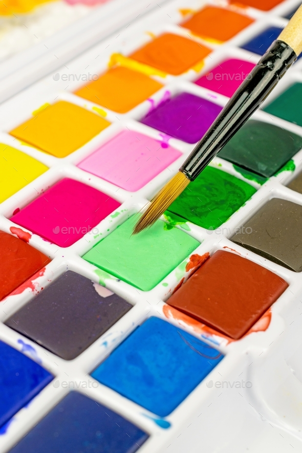 An Artists Paint Brush and Pallet - Stock Photo - Images