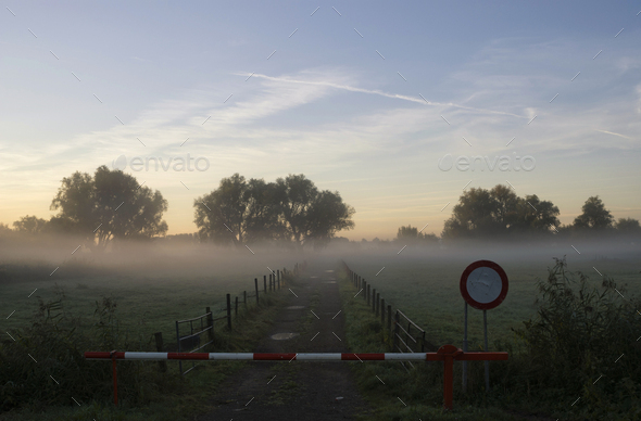Closed barrier in mist - Stock Photo - Images