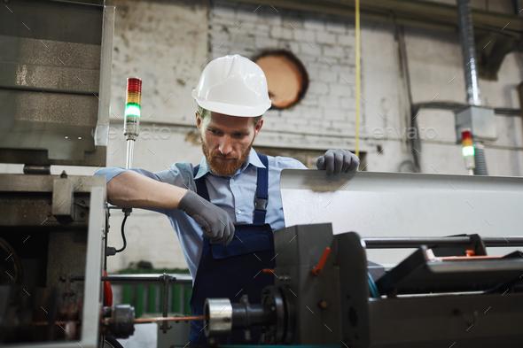 Engineer examining the machine - Stock Photo - Images