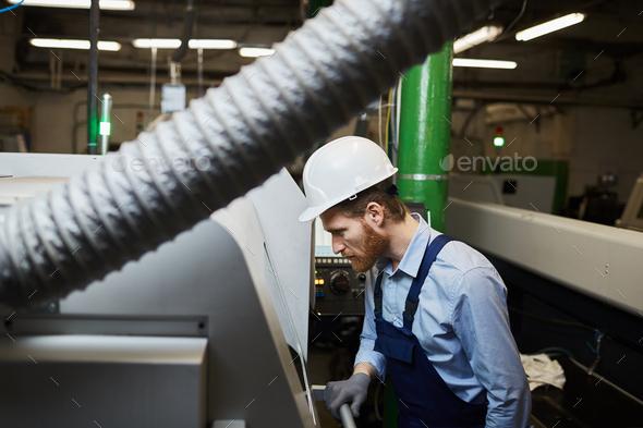 Technician working on lathe