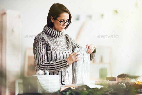 Woman wrapped present - Stock Photo - Images