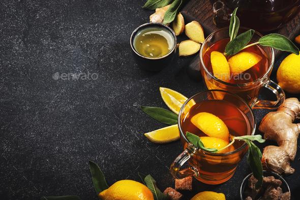 Healing black herbal tea with ginger, honey, lemon and sage - Stock Photo - Images