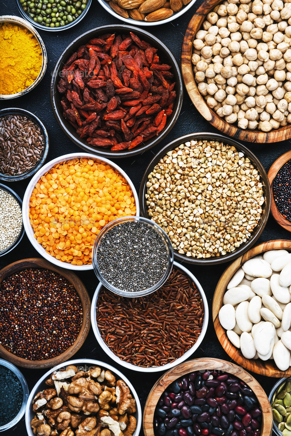Superfoods, legumes, nuts, seeds and cereals selection in bowls - Stock Photo - Images
