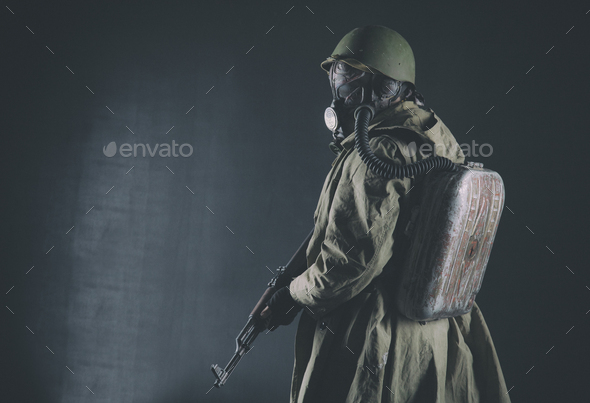 Post apocalyptic soldier aiming firearm weapon - Stock Photo - Images