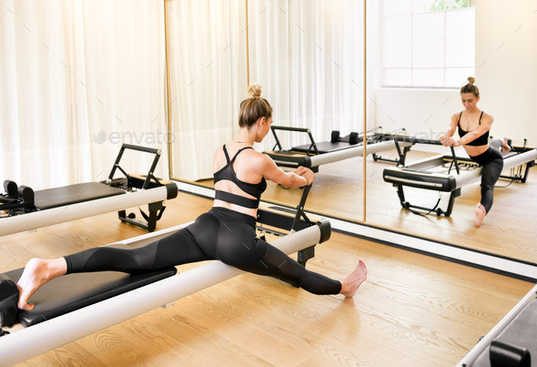 Woman doing a stretch lunge pilates exercise - Stock Photo - Images