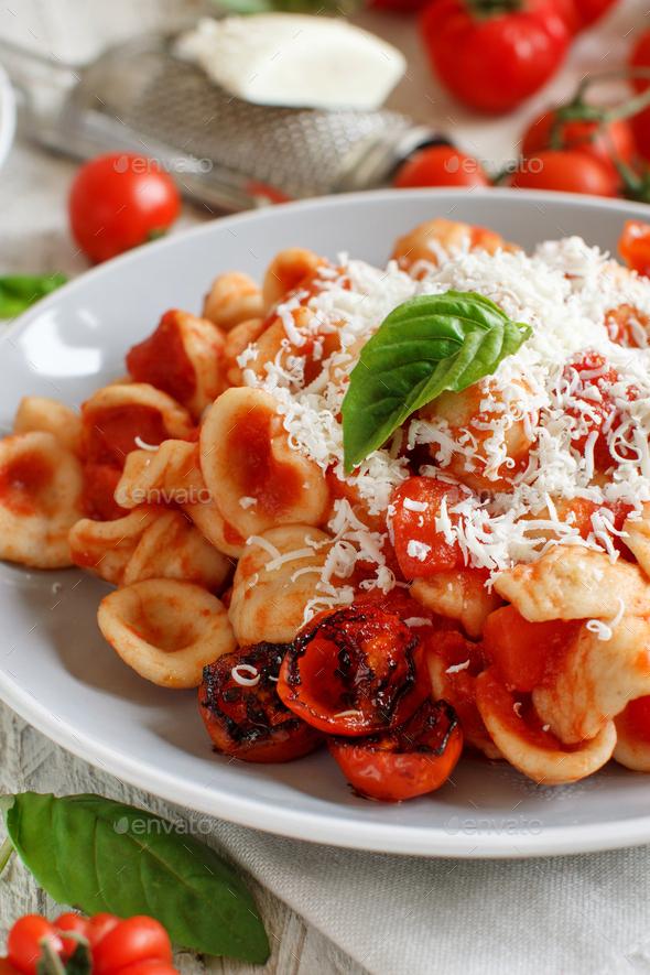 South italian  pasta orecchiette with tomato sauce and cacioricotta cheese - Stock Photo - Images