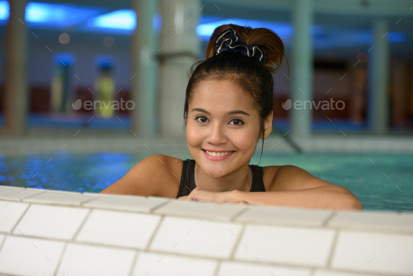 Face of happy young beautiful Asian tourist woman relaxing at the spa - Stock Photo - Images