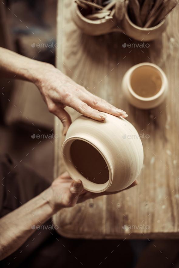 Close up of Female Hands Examining Ceramic Bowl at Workshop - Stock Photo - Images