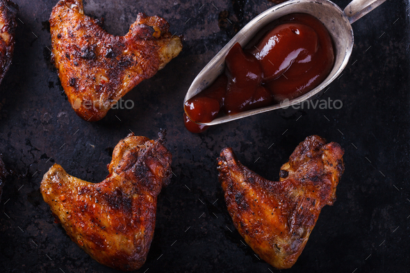 Chicken wings fried on the grill with BBQ sauce - Stock Photo - Images