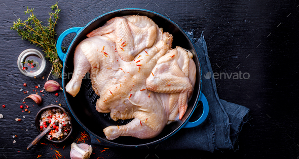 Whole Raw Chicken with Herbs and Spices .Food Ingredient Cooking Background - Stock Photo - Images