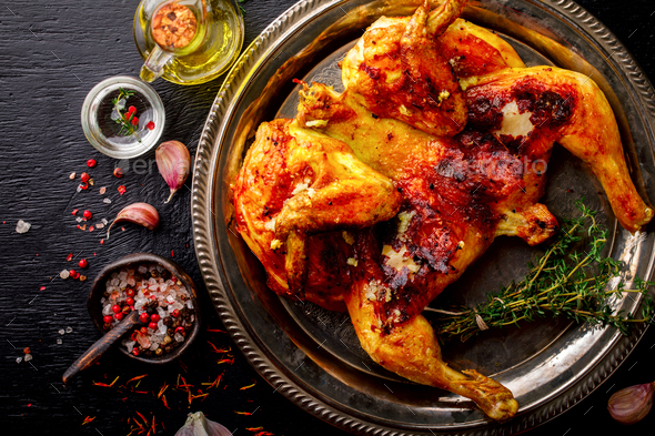 Grilled fried roast Chicken Tabaka - Stock Photo - Images