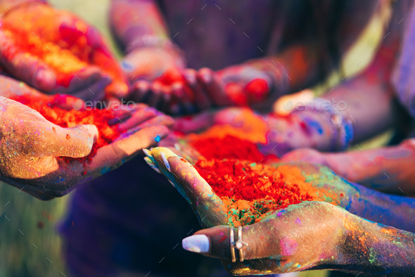 Close-up Partial View of Young People Holding Colorful Paint in Palms at Holi Festival - Stock Photo - Images