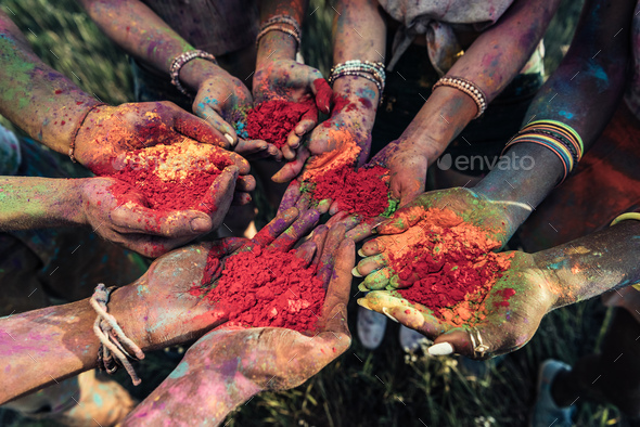 Close-up Partial View of Young People Holding Colorful Powder in Hands at Holi Festival - Stock Photo - Images