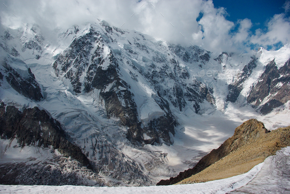 Scenic Landscape With Snowy Mountains and Cloudy Sky, Russia, Caucasus - Stock Photo - Images