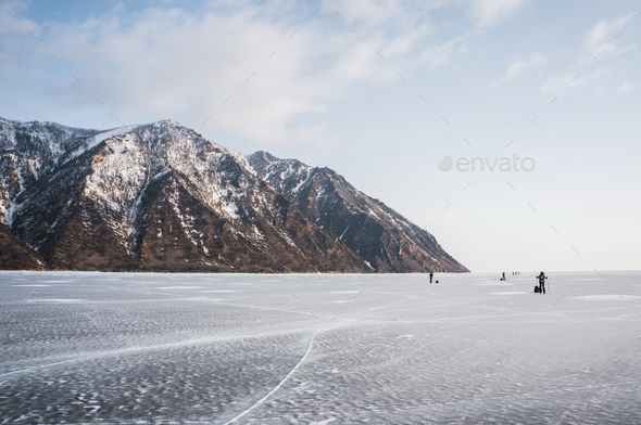 Scenic View of Frozen River With Snowy Mountains in Winter, Russia, Lake Baikal - Stock Photo - Images