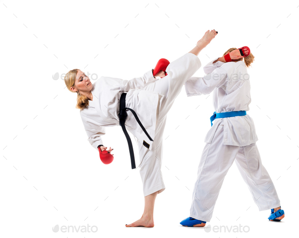 Cute blonde girls training karate on white - Stock Photo - Images