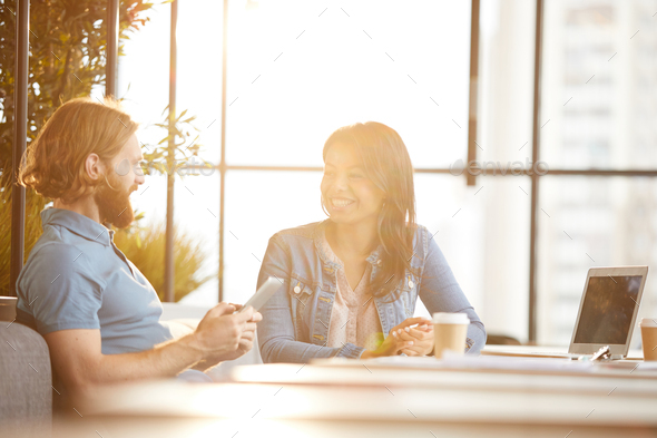 Business colleagues sitting in cafe - Stock Photo - Images