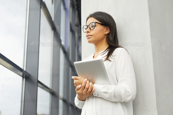 Businesswoman with tablet pc at office - Stock Photo - Images
