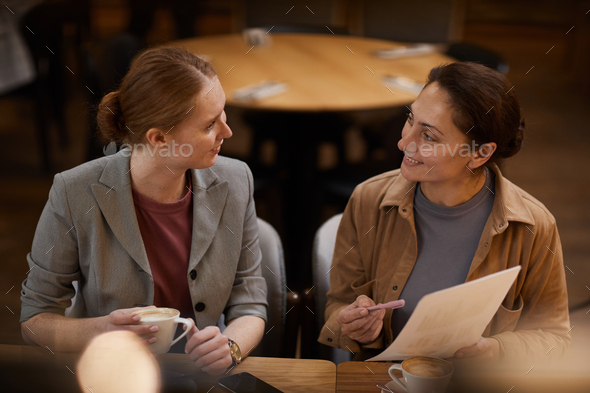 Businesswomen discussing contract - Stock Photo - Images