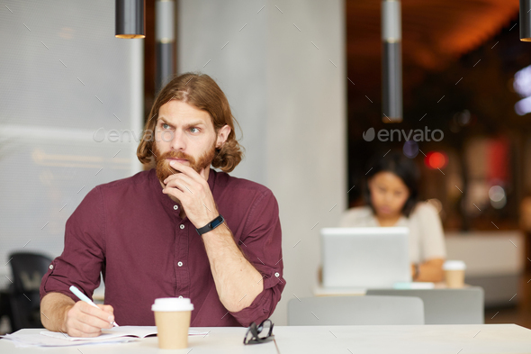 Pensive businessman planning his work - Stock Photo - Images
