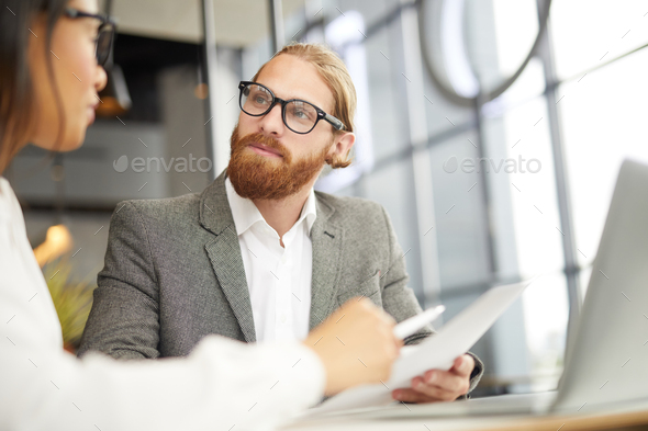 Serious businessman working with partner - Stock Photo - Images