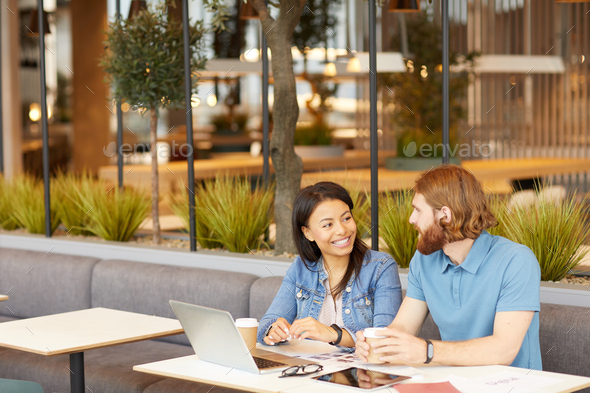 Business partners have a conversation in cafe - Stock Photo - Images
