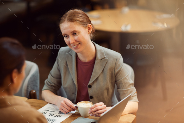 Business partners have a meeting in cafe - Stock Photo - Images