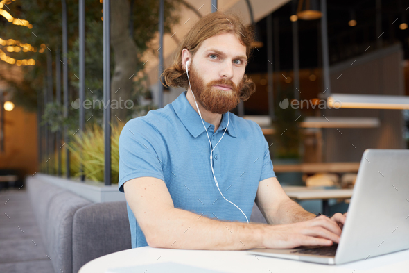 Man working online in cafe - Stock Photo - Images
