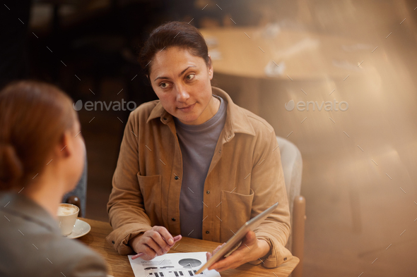 People at meeting in cafe - Stock Photo - Images