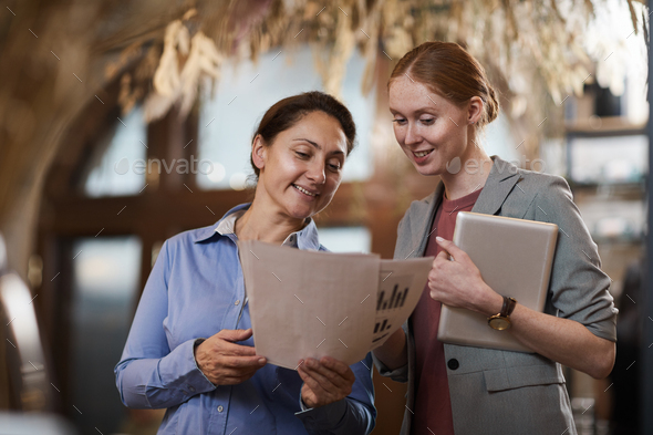 Business people examining financial report - Stock Photo - Images