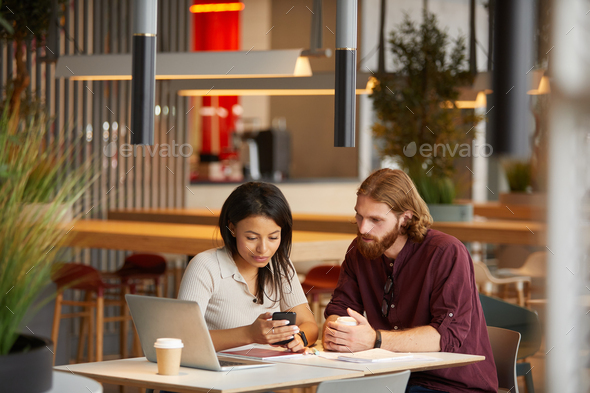 Teamwork during meeting in cafe - Stock Photo - Images