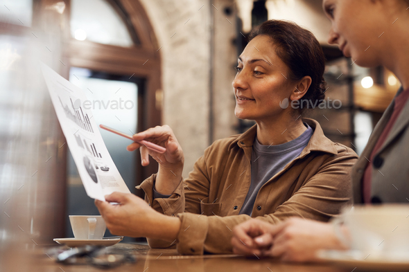 People discussing financial report - Stock Photo - Images