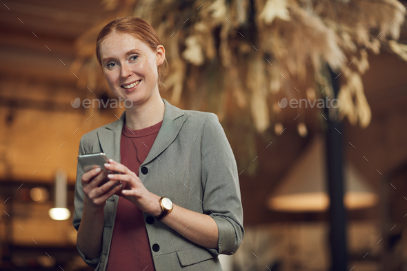 Businesswoman with mobile phone - Stock Photo - Images