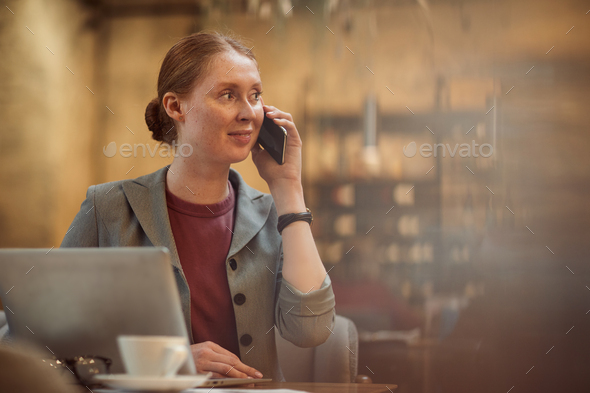 Businesswoman busy on the phone - Stock Photo - Images