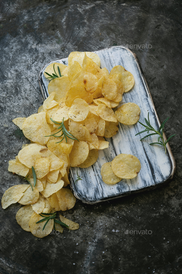 Crispy potato chips with salt and seasonings - Stock Photo - Images